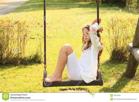 girls on swings kid sad girl on swing stock photo image 45676532