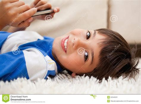 Floor Plans For Free by Boy Lying On The Carpet With Cellphone Stock Image Image