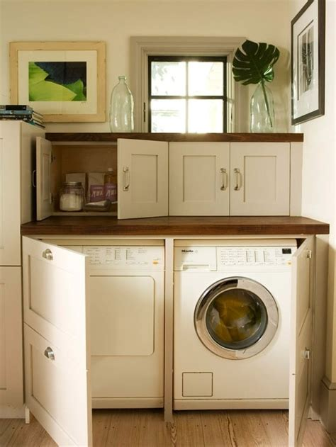 hidden washer and dryer cabinets pin by nicole crossan on dream house