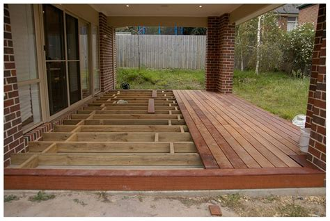 backyard wood deck wood deck over concrete patio bordered edge rather than baseboard patio porch