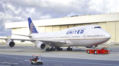 this boeing 747 is being united airlines boeing 747 400 n178ua being towed at san