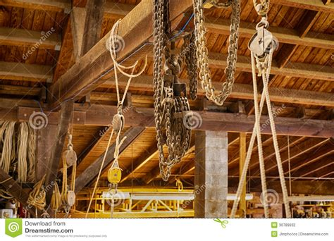 block and tackle in boat shop stock photography image