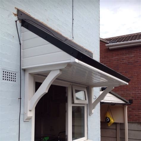 Flat Roof Awning by Canopies Roofing Flat And Pitched Canopy