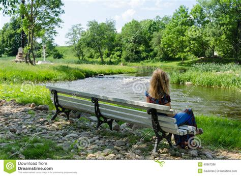 stream bench woman on bench admire fast flow river water stream stock photo image 40967286