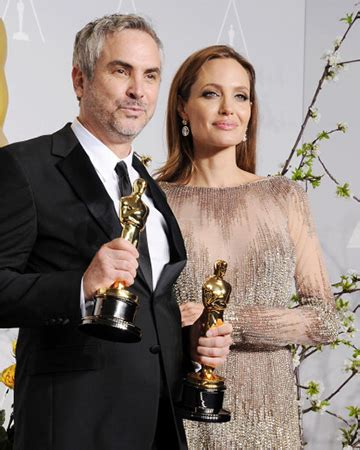 alfonso cuaron on how angelina jolie and robert downey jr baby names inspired by 2014 oscar winners