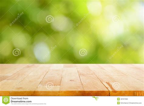 wood table top  bokeh abstract green background stock