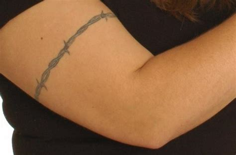 explore the meaning of a barbed wire tattoo and be surprised