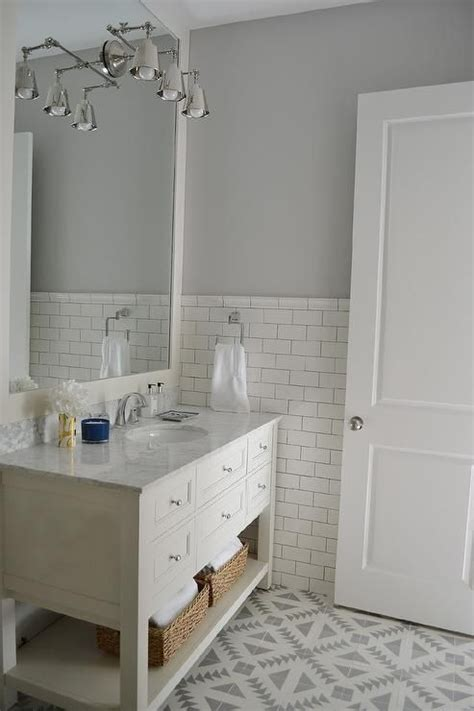 Bathroom Half Tiled Half Painted by White And Gray Bathroom Features Top Half Of Walls Painted Gray And Bottom Half Of Walls Clad In