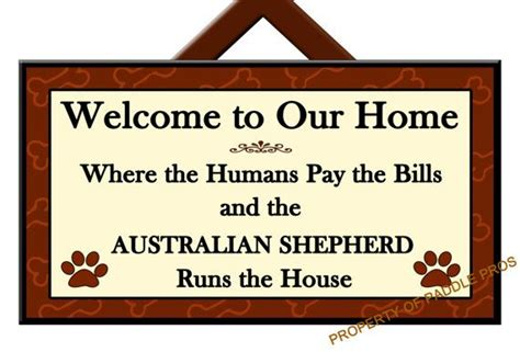 welcome to the home of new beginnings shepherd rescue australian shepherd runs the house welcome sign dog