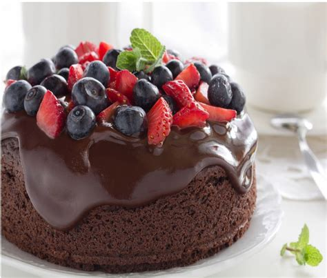 delicious cake with tempting chocolate sauce and berries are you drooling yet dessert