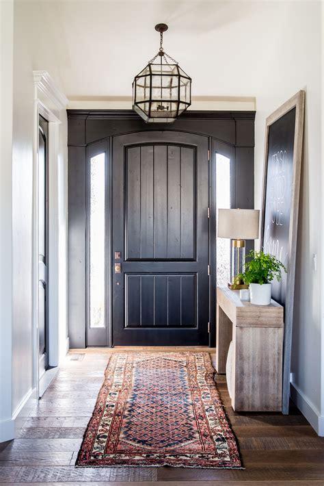 entryway  black front door   kilim rug entry