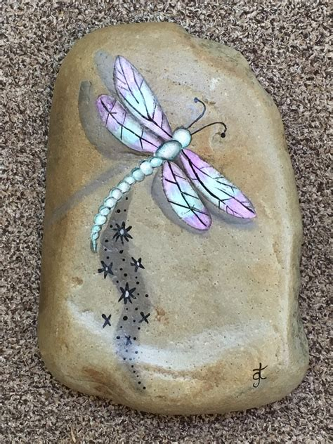 Dragonfly painted on rock for the garden.   Gardening Dreams