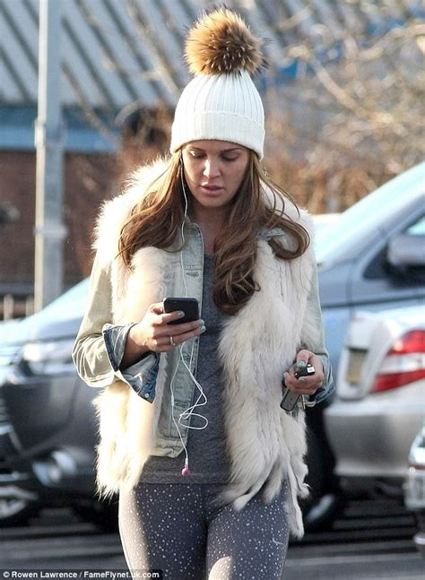 Wags Go Burlesque by Danielle Lloyd Dons A Bobble Hat And Faux Fur Gilet