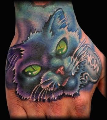 cat tattoo in hand scary cat tattoo on hand