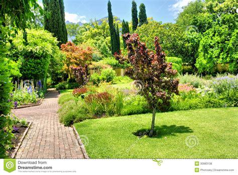 Modern Kitchen Designers beautiful garden in sunlight royalty free stock photos