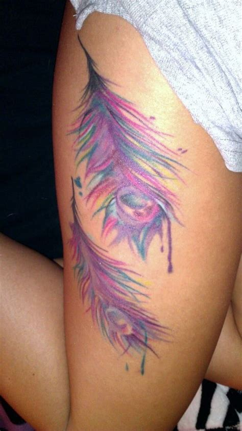 feather tattoo on upper thigh water color peacock feathers pastel flower tropical