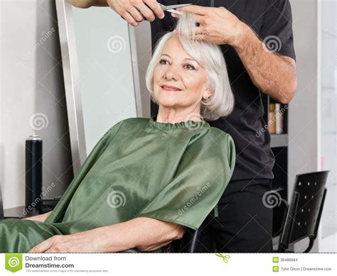 old ladies hair salon woman having hair cut at salon stock images image 36486984