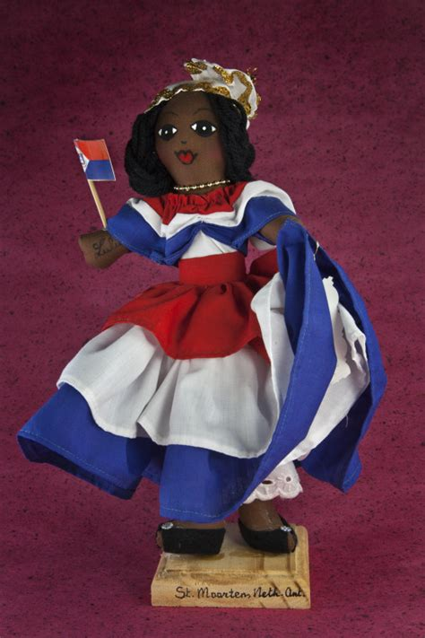 Handcrafted By St - st maarten handcrafted doll holding flag for
