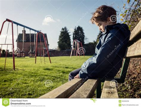 how to play park bench lonely child sitting on play park playground bench stock