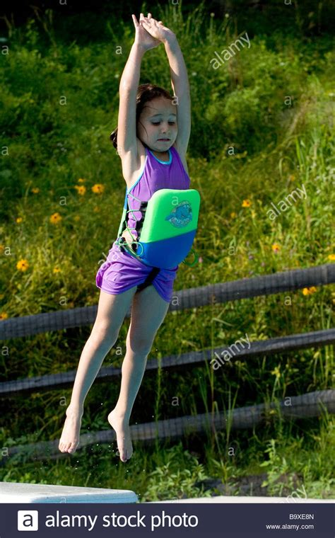 girl 8 yrs and boy 5 yrs swimming underwater in a pool part 2 of 5 year old girl jumping off diving board into swimming