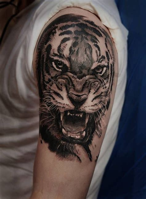 realistic tiger tattoo realistic tiger on the left arm and shoulder