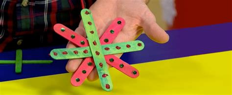 Mister Maker Craft Games Kids - a christmas tree decoration made from lollipop sticks