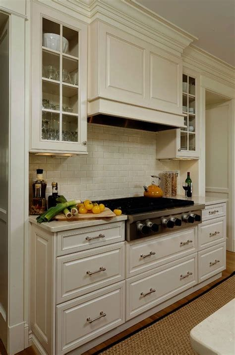 the stove cabinet like range with glass front cabinets flanking