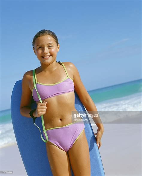 Portrait Of A Girl Holding A Surfboard And Standing On The Beach Bermuda Photo Getty Images