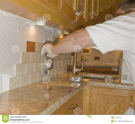 kitchen backsplash tile installation ceramic tile installation on kitchen backsplash 12 royalty free stock photos image 13321318