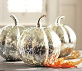 Inexpensive glass pumpkins receive a coat of looking glass spray paint