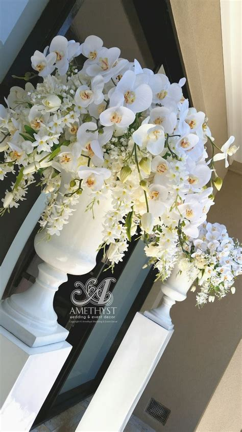 All White Wedding Flower Arrangements by 1000 Ideas About Orchid Arrangements On
