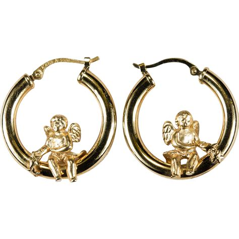 Hoop Earrings With swinging cupid hoops 14k gold designer hoop earrings from