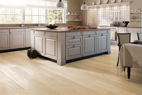gray laminate flooring with oak cabinets