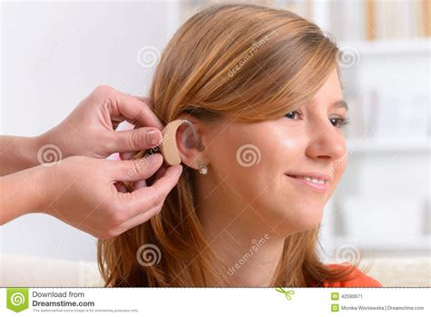 wraring hearing aid washed hair woman wearing deaf aid stock photo image 42590671