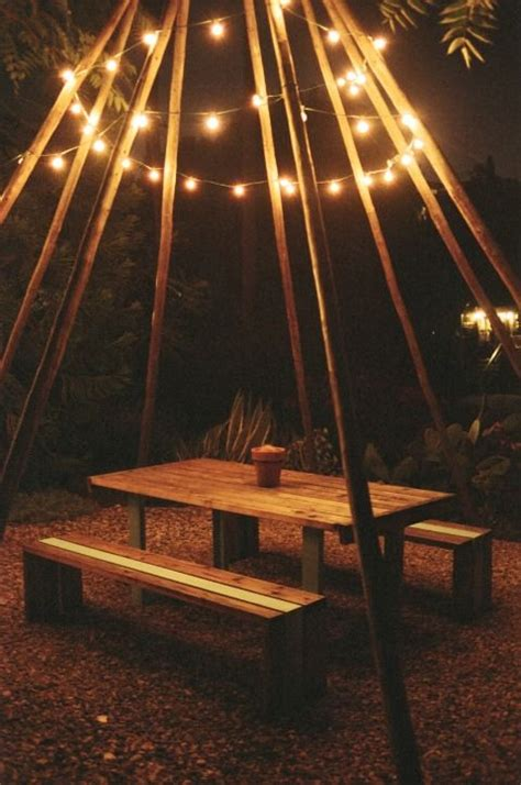 tipi teepee poles placed picnic table draped with