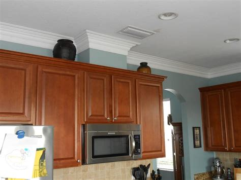 space between kitchen cabinets and ceiling kitchen crown molding work if the cabinets have a gap