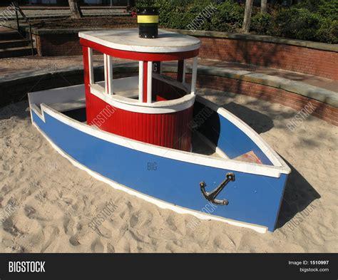 blue boat sandbox tugboat sandbox stock photo stock images bigstock