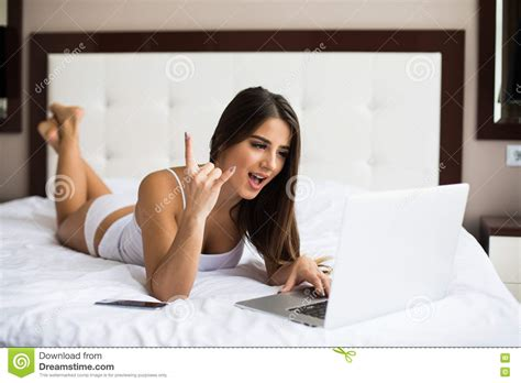 laptop in bed woman have idea and write this in laptop in bed computer