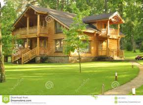 beautiful wooden house in the forest stock photo image