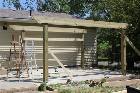 Building A Pergola On A Patio by How To Build A Pergola In Two Days On A Budget Detailed