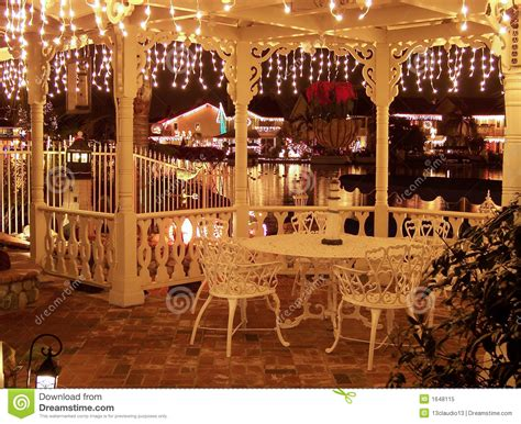 Lighthouse Floor Plans christmas lights decorated gazebo overlooking a reflective