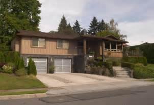 Trim glass and aluminum garage doors and gravel driveway inserts