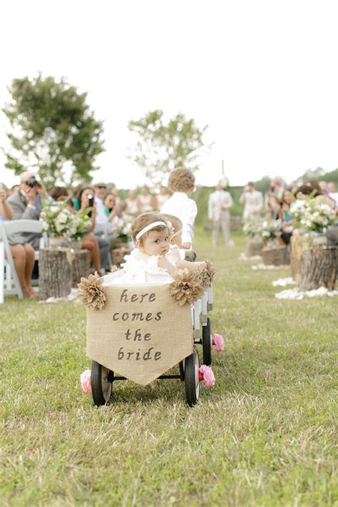 here are all the models walking in this years victorias 25 wagon wheelbarrow country wedding ideas deer pearl