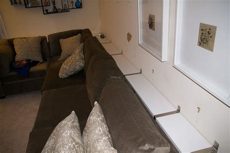 She Put IKEA Shelves On The Wall, Then Did THIS With The Couch. Brilliant!