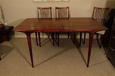 mid century modern dining table and six chairs at
