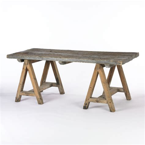 sawhorse desk rustic wood dining table with sawhorse legs wood varies in color and texture w 76 5 in 215 d