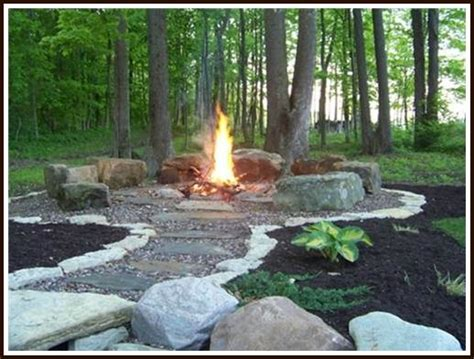 build your own backyard fire pit get started building your own backyard fire pit with these