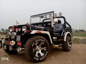 modified jeep. mahindra hunter jeep a red wild orchad