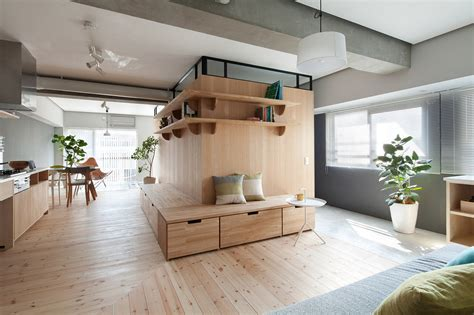 japanese home design studio apartments l shaped wood partition unifies all areas in small