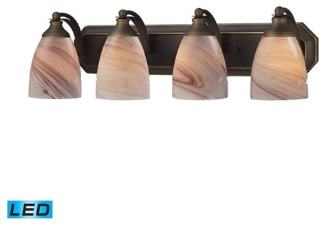 Tropical Bathroom Lighting Four Light Aged Bronze Creme Glass Vanity Tropical Bathroom Lighting And Vanity Lighting